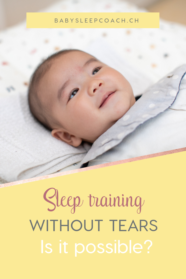 "Smiling baby on a changing table. Text reads ""Sleep training without tears. Is it possible?"""