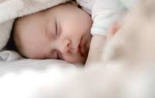 sleeping baby using gentle sleep training methods